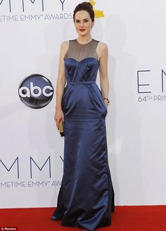 Not a loser in the style stakes: Despite missing out on an award at Sunday night's Emmys, Downton Abbey's Michelle Dockery wowed in her midnight blue gown