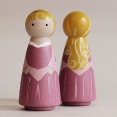 A set of 3 hand painted wooden peg dolls depicting Snow White, Cinderella, and Aurora. Wonderful attention to detail! Create the magic of play for children with these beautifully hand painted and Waldorf-inspired, original Peg Doll Creations! Encouraging children to play imaginatively and creatively with Handmade Pixie Dust Peg Dolls inspires and aids in early childhood development. *Set of 3 *3.5in tall *Solid wood *Painted with non toxic paint and a satin varnish. *Made to Order The…