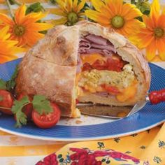 BREAKFAST LOAF...STUFFED WITH DELI HAM, SCRAMBLED EGGS, MONTERY JACK CHEESE, CHEDDAR CHEESE, SWEET RED PEPPER AND TOMATO... If you like, add sliced mushrooms and olives