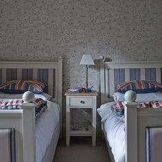 Children's bedroom with map wallpaper and twin beds | Renovated Wiltshire manor house | House tour | PHOTO GALLERY | Homes & Gardens | Housetohome.co.uk