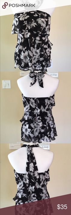 WHBM RUFFLE HALTER TOP Brand new w tags halter top. Floral pattern in black white & gray colors.  Ruffles are asymmetrical & cover the blouse front & back. Very cute w a pair of jeans or slacks & jacket. White House Black Market Tops Blouses