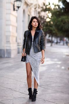 Grey high low skirt. black leather biker jacket. booties.