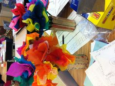 National School Counseling Week. Here's a creative class gift I saw in my school! Tissue paper flowers on skewers in a water bottle, decorated with craft sticks that the kids wrote special messages on!