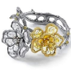@levinsonjewelers one of a kind arm art. Beautiful diamond slices for flower petals.