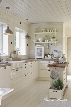 French Country Kitchen with Butcherblock Island #kitcheninteriordesigncontemporary #ContemporaryInteriorDesignkitchen #frenchkitchens #kitchenislands #frenchcountrykitchendesigndreamhomes