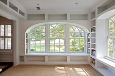 love that all the wall space is used for shelving.  beautiful window with seat and side book shelves