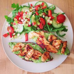 Grilled chicken and guacamole on toast and a salad on the side!