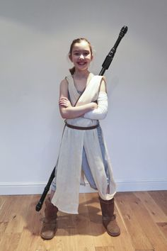 Emily in her Rey Costume with her staff strapped to her back and her hair in a Rey hairstyle