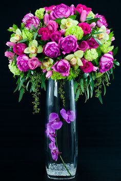 Pink & Purple arrangement - two of the big standard arrangements. 8 garden roses, 12 topas roses, 4 bunches of tulips, 6-8 blooms of green cymbidiums, some viburnums, madrona, seeded eucalyptus, and 1 stems of purple orchids in the vase. Clear stone in the Vase #flowers #Arrangement