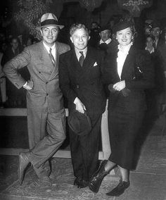 Ready to have their footprints done at Grauman's Chinese Theater: William Powell, Sid Grauman (of Grauman's Chinese Theater) and Myrna Loy. Note the clown shoes....... LOVE !