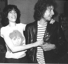 Bob Dylan & Patti Smith in her Keith Richards t-shirt, backstage at her June 26, 1975 show at New York's Bitter End: their first meeting! Photos by Chuck Pulin.