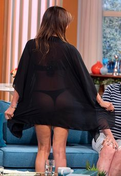 Lizzie Cundy donned a skimpy thong bikini and flashed her pert derrier on This Morning as part of a debate Thong Bikini, Bell Sleeve Top, Shows, Legs, Female, Celebrities, Bikinis, How To Wear, Black