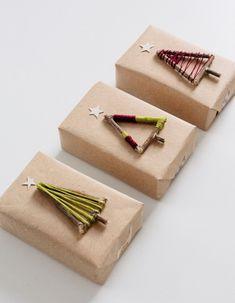 kreatív karácsonyi díszcsomagolás fonállal és ágakkal