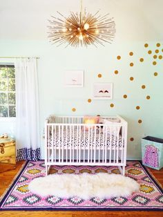 Name: Ruby Location: Valley Village, CA Room Size: 12' x 12' Ruby's nursery had me at hello. From the glamorous chandelier to the pattern play throughout the space, it isn't your typical baby room by any stretch of the imagination. Even though the space looks very high-end, I love that Ruby's mom Rachelle was able to save some money by searching sites like Craigslist and Etsy for budget-friendly versions of the pricier pieces that she loved. And my favorite part of the space? The genius…