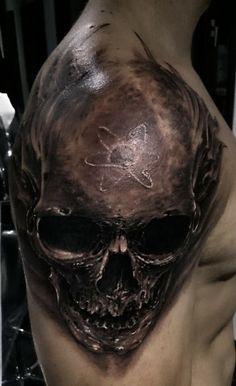 3D skull tattoo on shoulder