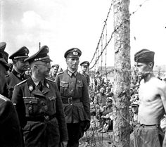 Nazi military commander Heinrich Himmler inspects the concentration camps only to be confronted by Prisoner of War Horace Greasley . Greasley would regularly escape from the camp and then sneak back in. Allegedly managed this over 200 times.His reason? He was meeting a local German girl in secret, with whom he'd fallen deeply in love with.