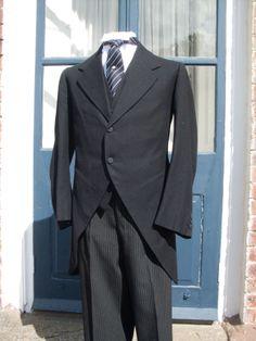 Morning dress. Matching dark coat and waistcoat.