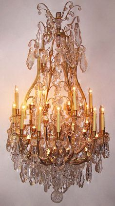 A Very Fine Palatial French 19th Century Louis XV Style Gilt-Bronze and Lead Crystal Sixteen Candle-Arms and Thirty Six Light Chandelier, Attributed to Baccarat. Circa: Paris, 1880