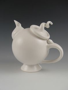 Hand thrown glazed ceramic tea pot.  I'm always looking for unusual tea pots.  When I worked at Ma Cuisine, a kitchen shop in Ottawa, we were always asked for teapots that didn't drip.  I can't tell you how many pots I tested for customers!