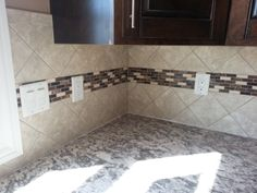 4x4 Tile backsplash set  at an diagonal with an accent stripe going through it