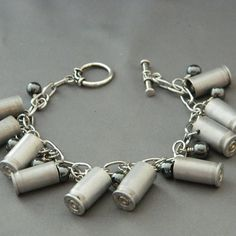 bullet charm bracelet.- so dang redneck but ONE bullet on my bracelet! THAT WOULD BE AWESOME!