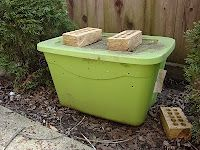 Beginning composting with a plastic bin and lots of drilled holes (or maybe a plastic garbage can). Would attach bungee cords and rotate it and add worms.