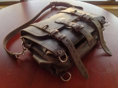 Here's a beautiful 4 year old Classic Briefcase in Dark Coffee Brown size medium.