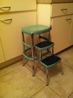 I happen to have one of these from my grandmother. Didn't know I was sitting on a mid-century step stool! Now that I have a 50s kitchen, it may be time to renovate this...