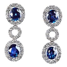 TIVOL Collection #sapphire and #diamond drop earrings  with pavé diamond halos around each sapphire.