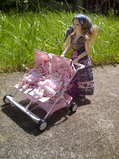 Dolls house stroller, a twin 'side by side' pushchair I made from scratch with reclining seats that move individually.