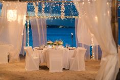 All White Wedding Beach Wedding Reception Setting. Purchase sheer white curtains to put on corner posts of gazebo