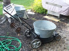 Repurposed Trash into Garden Carts.  Galvanized Tubs, Old lawn mower base, and assorted metals