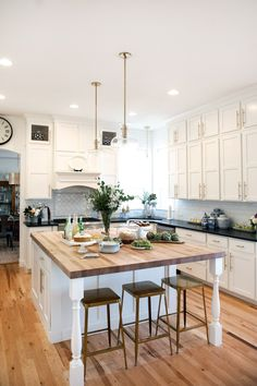 Suburban B's Fall 2016 One Room Challenge White Kitchen makeover White kitchen cabinets, brass stools, modern brass hardware, brass light fixtures, honed absolute black granite countertops, butcher block top island.
