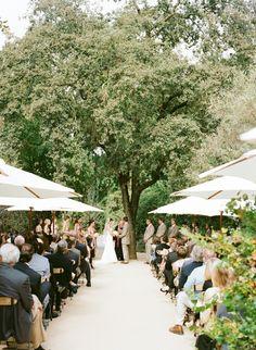 Beautiful Napa wedding ceremony with umbrellas!