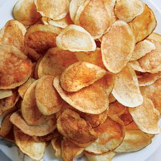 The crispiest potato chips ever. homemade chips, better and healthier than Lay's. Keys to great chips: A lower frying temp gets the moisture out; a vinegar soak ensures they're crisp. Deep Fried Potatoes, Fried Potato Chips, Crispy Potatoes, Potato Chips Homemade, Fried Chips, Potato Snacks, Potato Recipes, Potato Dishes, Vegetable Recipes