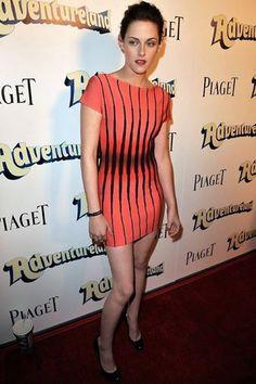 Kristen Stewart in Herve Leger coral and black dress.