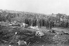 Air raid damage done at the St John's Ambulance Brigade Hospital at Etaples, May 1918. Among those inspecting the damage are some Salvation Army female workers.