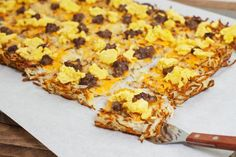 Enjoy hash browns, scrambled eggs, sausage and cheese in every bite with this one-of-a-kind breakfast pizza. Utensils need not apply.