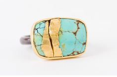 """Colorful gemstones like turquoise stood out aside the decade's color combinations and prints. This sterling silver and 22-karat """"Golden Joinery"""" turquoise ring is by Jamie Joseph ($1,630)."""
