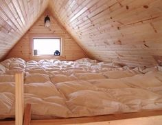 Mattress-covered attic loft for sleepovers.