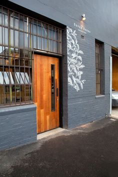 Seven Seeds Cafe, Melbourne, 2009 - Breathe architecture Warehouse Living, Warehouse Design, Building Front, Building Facade, Cafe Design, Store Design, Brick Cafe, Retail Facade, Painted Brick Walls