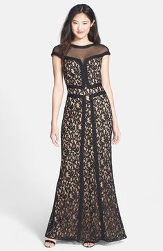 Free shipping and returns on Tadashi Shoji Illusion Yoke Lace Trumpet Gown at Nordstrom.com. A light, airy illusion yoke crowns a gorgeous lace trumpet gown while solid black trim visually traces and sculpts an hourglass silhouette.