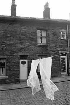 © Martin Parr - Washing hanging in the street, Cornholme, West Yorkshire, England Contemporary Photography, Monochrome Photography, Urban Photography, Amazing Photography, Street Photography, Landscape Photography, Martin Parr, Magnum Photos, West Yorkshire