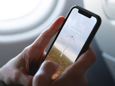 Free iPhone XS on a Plane Mockup #mockup #iphone #iphonexs #free #mobile #iphonemockup #iphonemockups #freemockups