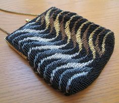 """fabulous vintage metallic beaded evening bag - jewel tones of bronze, gold, silver, grey and black .. beautiful beadwork of glass seed beads and petite rocailles in shiny metals .. smooth satiny soft lining of black poly fabric with an interior pocket .. flexible light weight chain handle that can also be hidden inside turning this lovely bag into a clutch //  Size - 5.75"""" wide x 6 3/8"""" tall"""