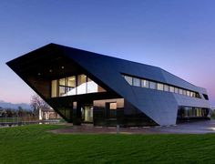 Dark Faceted Office Building Exposing An Asymmetric Shell