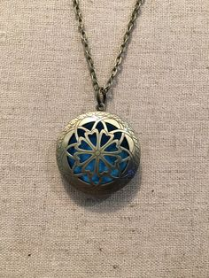"Essential Oil Diffuser Aromatherapy Pendant, necklace jewlery locket antique silver or bronze 24"" Chain and 5 aroma pads"