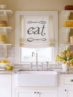 love this whole look- pops of yellow, farm sink, open shelving, subway tile with dark grout -- I want to paint our new kitchen light yellow!!