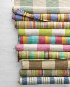 Reversible handwoven cotton rugs add a burst of brilliance to casual cottage decor. Made to mix and match in five distinctive striped patterns.Love!