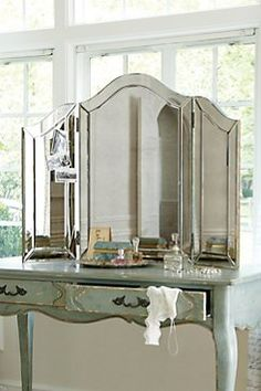 Brigitte Tri-Fold Vanity Mirror The fairest of them all, Brigitte combines gothic Venetian influence with a large helping of Hollywood glamour. Chic atop a vanity, or your fav